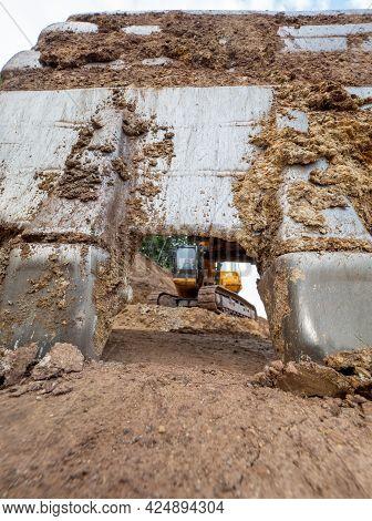 Cracked Earth Under Excavator Bucket Bite The Ground. Backhoe Bucket. Green Mind Theme