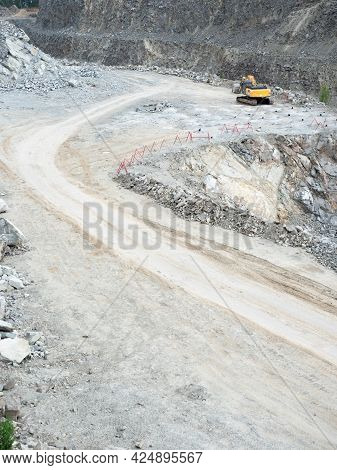 Excavator Working On Earthmoving At Open Pit Mining. Backhoe Digs Granite Gravel In Quarry