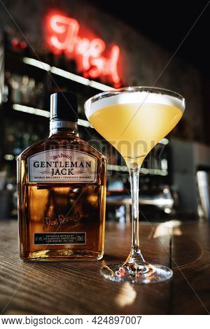 Yellow Gourmet Cocktail With Gentleman Jack Whiskey On The Bar Bottle Of Jack Daniel's