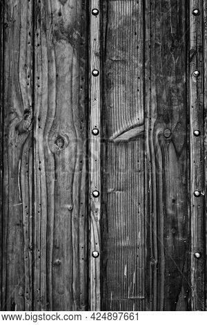 Ancient Wooden Door With Metal Rivets In Black And White