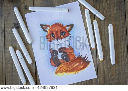 Flat Lay With Sketching Ittle Red-haired Cute Fox With A Bushy Tail. All Placed On Wooden Table Pict
