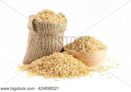 Dry Brown Rice Seed Pile In Sack And Wooden Bowl On White Background, For Carbohydrate Food Raw Mate