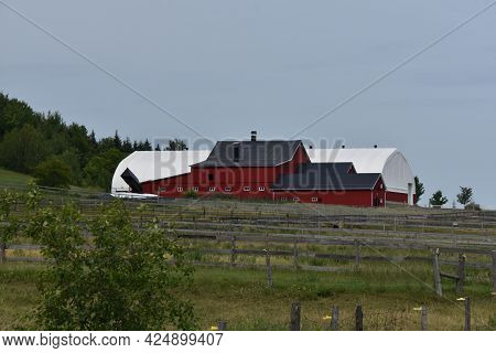 Barn On A Farm In The Canadian Countryside In Quebec