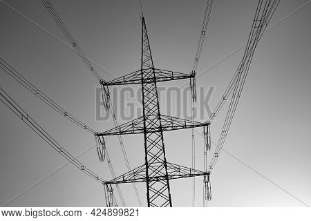 Crossing Electric Pylon In Black And White Sunset Sky