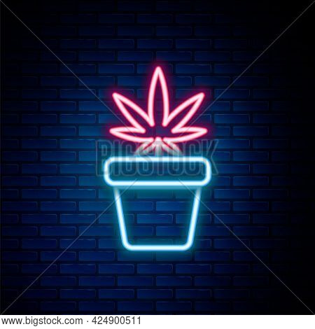 Glowing Neon Line Medical Marijuana Or Cannabis Plant In Pot Icon Isolated On Brick Wall Background.