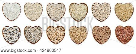 Collection Of Dry Organic Cereal And Grain Seeds In Heart Shape Wooden Bowl Isolated On White Backgr