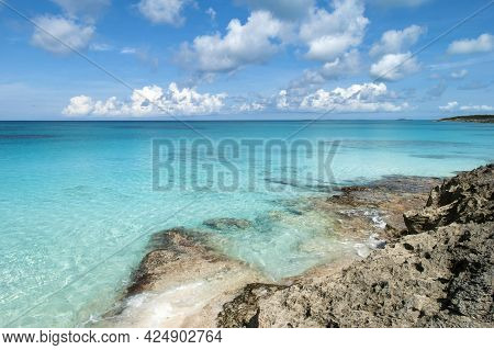 The Scenic View Of Half Moon Cay Rocky Coastline And Turquoise Color Transparent Waters (bahamas).