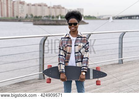 African American Girl Hipster Happy Smile Hold Longboard Outdoors. Casual Afro Female Skater With Sk