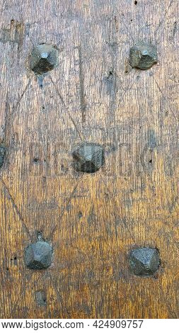 Close Up Of A Medieval Wooden Door And Iron Rivets