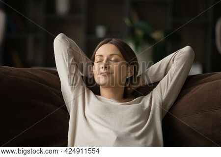 Mindful Happy Relaxed Young Woman Sleeping On Comfortable Sofa.