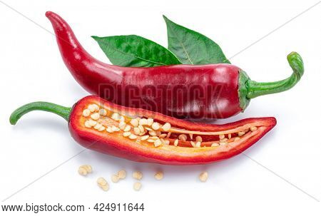 Fresh red chilli pepper and cross section of chilli pepper with seeds isolated on white background.