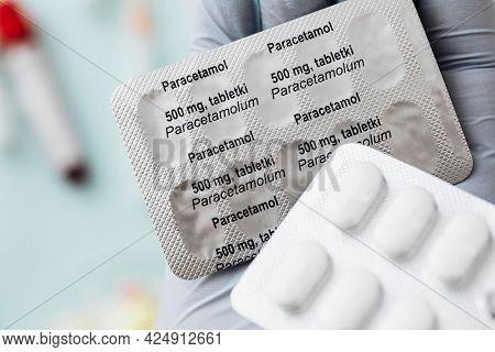 Hand holding paracetamol medicine packets