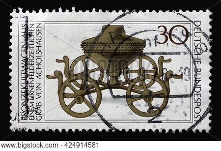 ZAGREB, CROATIA - AUGUST 28, 2014: A stamp printed in Germany shows Archaeological Treasures: Bronze ritual chariot c. 1000 B.C., circa 1976