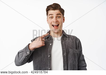 Surprised Happy Guy Being Chosen, Pointing Finger At Hismelf And Smiling Amazed, Winning Something,