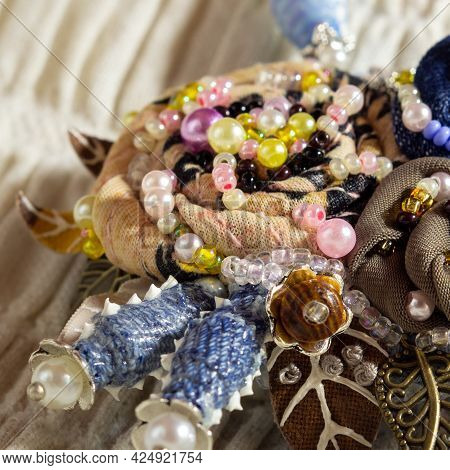 Embroidered Flowers Decorated With Beads And Pearls. Handiwork.