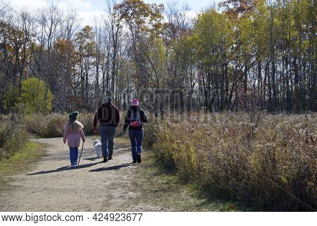 Toronto, Ontario / Canada - October 31, 2020: Family Hiking In The Forest Footpath With Social Dista