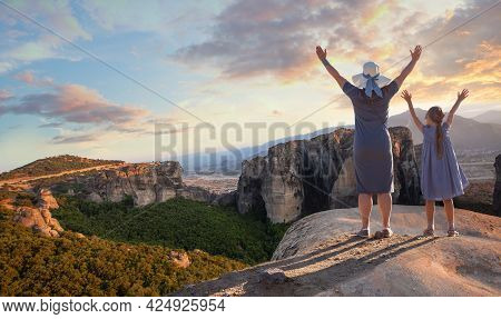 Happy Family Mother And Daughter Exploring Meteora Valley, Central Greece, Largest Complexes Of East