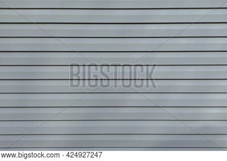 Gray Vinyl Siding. Background And Texture Of Plastic Siding.