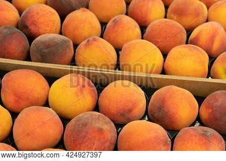 Close Up Beatiful Fresh Raw Peaches In A Wooden Crate