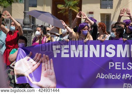 Valencia Spain. June 26, 2021 - A Group Of Women Carrying A Banner During A Protest In Defense Of Eq