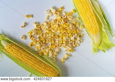 Yellow Popcorn And Corncobs And Raw Corn, Salt And Sweet Tastes