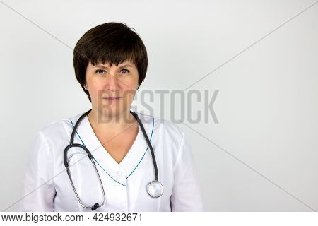 Ambulance, Cardiology, Healthcare. Doctor In White Coat With Stethoscope Pointing. Health Care And P