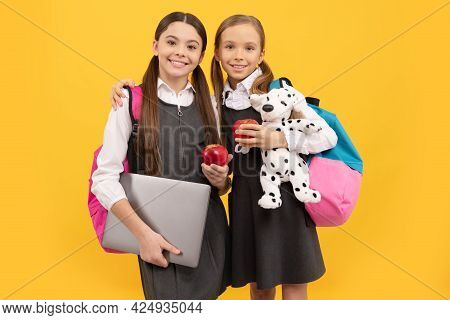 Hungry School Children In Formal Uniforms Hold Apples For Healthy Diet, Dieting