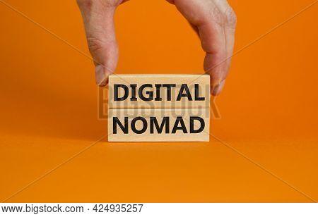 Digital Nomad Symbol. Wooden Blocks With Words Digital Nomad On Beautiful Orange Background, Copy Sp