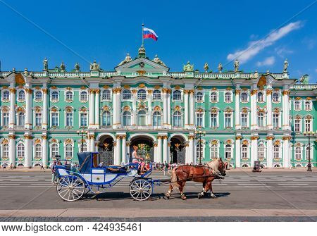 Saint Petersburg, Russia - June 2021: Horse Carriage On Palace Square With Hermitage Museum At Backg