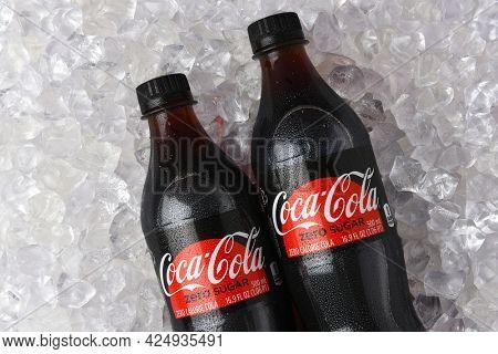 IRVINE, CALIFORNIA - 26 JUNE 2021: Closeup of two plastic bottles of Coca-Cola Zero in a bed of ice.