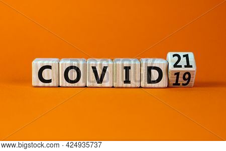 Symbol Of Covid-19 Pandemic In 2021 Year. Turned The Wooden Cube And Changed Words 'covid-19' To 'co