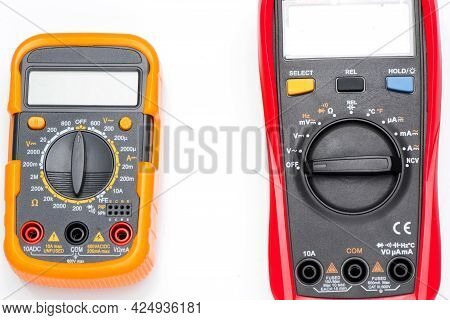 Electronic Digital Multimeter Isolated On White With Probes. Digital Multimeter With Red And Black L