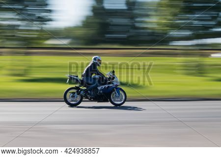 Motorcycle Bmw S 1000 Rr Drives At High Speed Down The Road. Motion Blur. Riga, Latvia - 15 Jun 2021