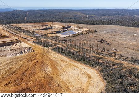 Drone Aerial Photograph Of The Construction Of An Industrial Sand Quarry In A Forest Affected By Sev