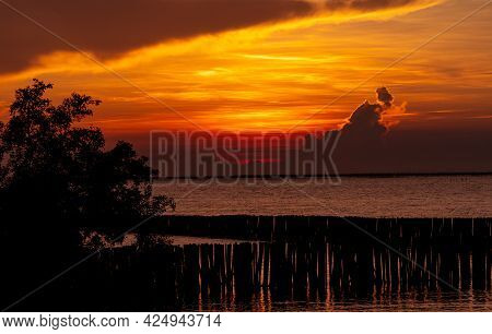 Beautiful Red And Orange Sunset Sky Over The Tropical Sea. Red Sunset Sky. Skyline At The Sea. Tropi