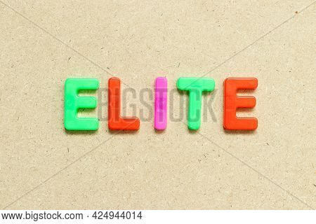 Color Alphabet Letter With Word Elite On Wood Background