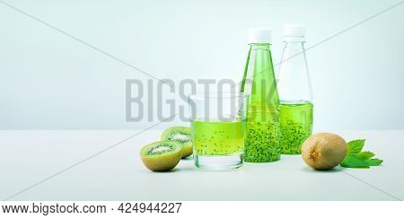 Green Detox Smoothie Kiwi And Mint On Light Green Background With Copy Space. Banner.