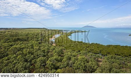 Aerial View Of Cape Palmerston Australia Looking Over Bushland And Ocean Towards An Island On The Ho