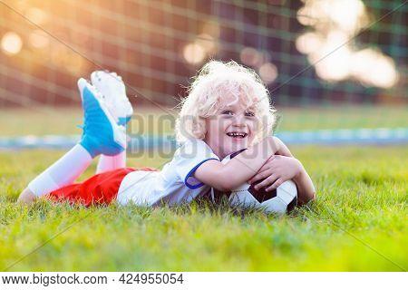 Kids Play Football On Outdoor Field. England Team Fans. Children Score A Goal At Soccer Game. Little