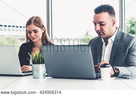 Businessman Executive Is In Meeting Discussion With A Businesswoman Worker In Modern Workplace Offic