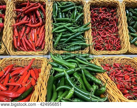 Fresh Chillies Variety Piled In The Baskets On The Market. Red Cayenne, Green Cayenne, Red Chilli, J
