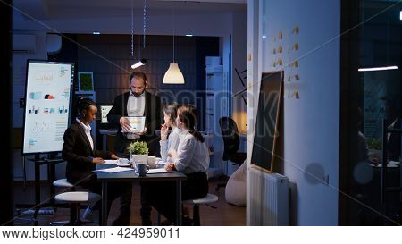 Workaholic Overworked Businessman Explaining Company Strategy Using Tablet For Presentation Working