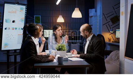 Executive Manager Woman Explaining Management Statistics Working At Company Strategy Overtime In Off