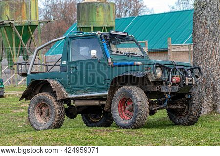 Gulbene, Latvia - May 02, 2021: Compact Japanese Suv Suzuki With Off-road Tuning In A Farmyard