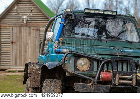 Gulbene, Latvia - May 02, 2021: Compact Japanese Suv Suzuki With Off-road Tuning In A Farmyard, , Cl