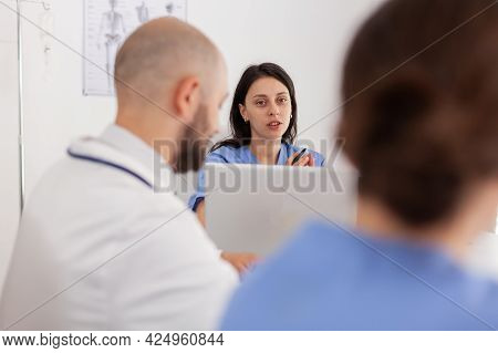 Portrait Of Woman Nurse Analyzing Healthcare Expertise Discussing Medical Examination With Hospital
