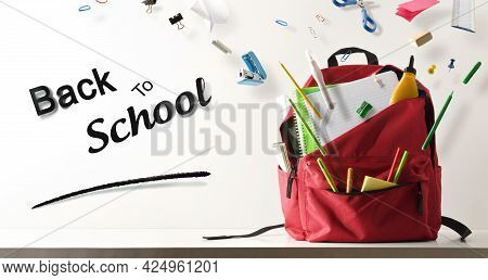 Study Desk And School Supplies Flying Coming Out Of A School Backpack And Back To School Text With W