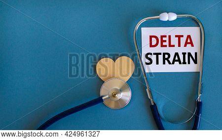 New Covid-19 Delta Strain Symbol. White Card, Words \'delta Strain\' And Stethoscope, Blue Backgroun