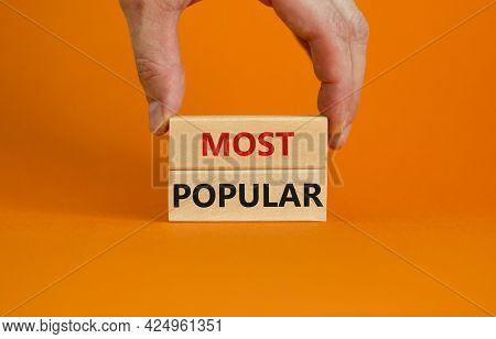 Most Popular Symbol. Concept Words Most Popular On Wooden Blocks On A Beautiful Orange Background. B