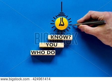 Who Do You Know Symbol. Businessman Hand, Light Bulb Icon. Wooden Blocks With Words 'who Do You Know